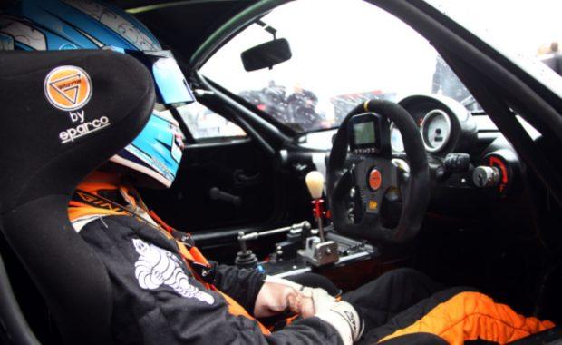 Max Bird sitting in Race Car